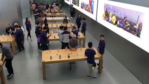 HONG KONG, CHINA - MARCH 16, 2017: People inside the Apple Store at Genius Bar. As of 2014, Apple employs 72,800 permanent full-time employees, maintains 437 retail stores in fifteen countries.