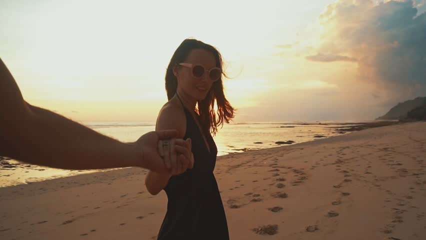 Leading Holding Hands Beach