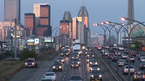 Toronto, Canada - CIRCA October, 2007: Wide view of the skyline with a highway in the foreground during dusk