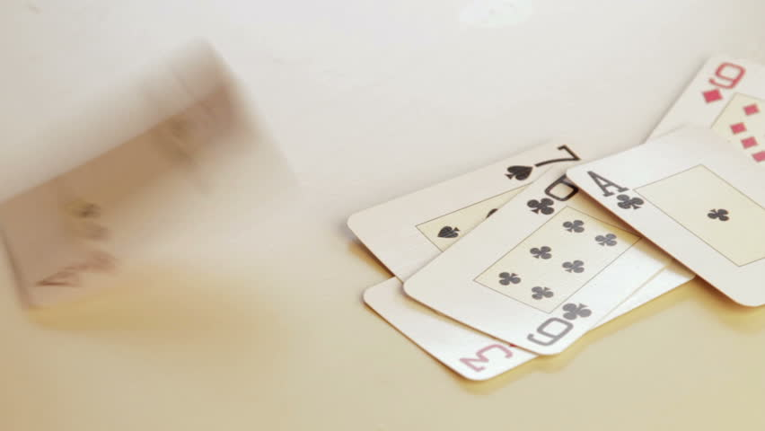 dealing pack of playing cards showing Ace of diamonds at the end