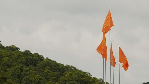 Set of flags of Vietnam against the backdrop of the mountain.