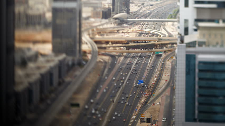 Timelapse shot over Sheikh Zayed Rd, showing the new MTR track and station system and the Burj Khalifa, the worlds tallest building, Dubai, UAE | Shutterstock HD Video #2565728