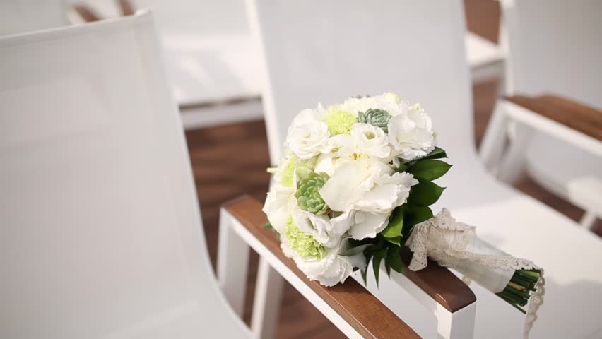 Bridal bouquet of roses and eucalyptus on a table. Wedding in Montenegro. | Shutterstock HD Video #25682798