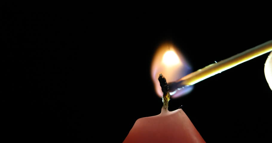 Lighting A Dark Room candle in a dark room light a candle and then extinguish stock