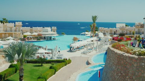 Sharm el Sheikh, Egypt, March, 2017: A luxurious hotel on the first line of the Red Sea. A large swimming pool. Steadicam shot