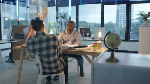 4K Creative business team brainstorming with sticky notes in modern office