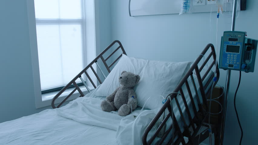 A teddybear stuffed animal with an IV recovering in a hospital bed next to a window, slow motion, 4K