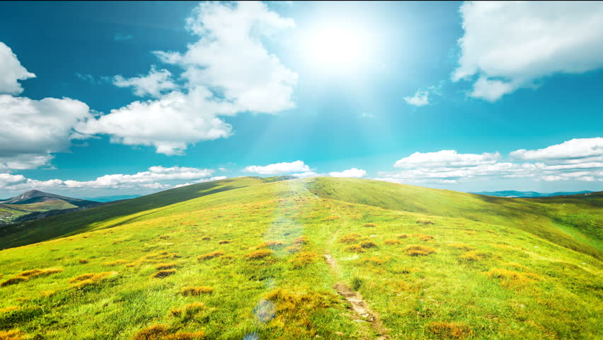 Beautiful green meadow mountain path. Blue sky with clouds and sun motion. Exploring beauty world: Carpathian mountains, Ukraine, Europe. Travel, hiking, holidays. Nature landscape. Slow motion 4K   Shutterstock HD Video #25755488