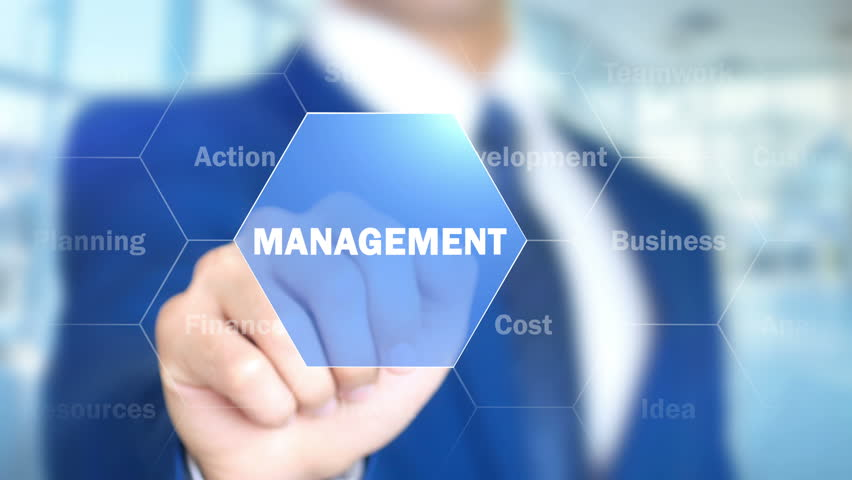 Management, Businessman working on holographic interface, Motion Graphics | Shutterstock HD Video #25761278