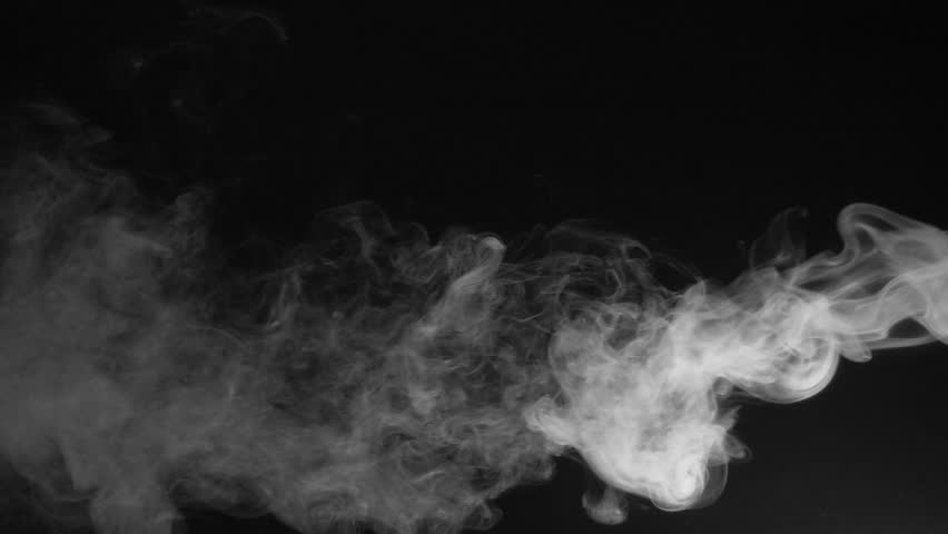 White Fume After Explosion Dissipating On Black Background Slow Motion