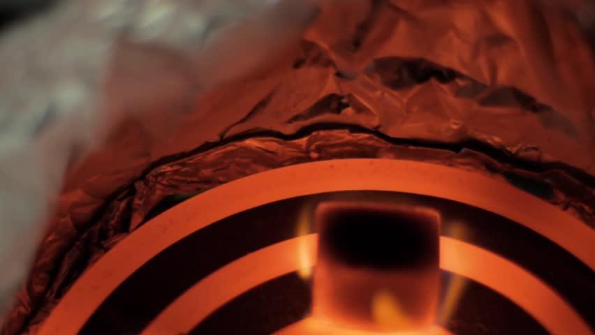 Burning coconut coals for hookah closeup 50 fps