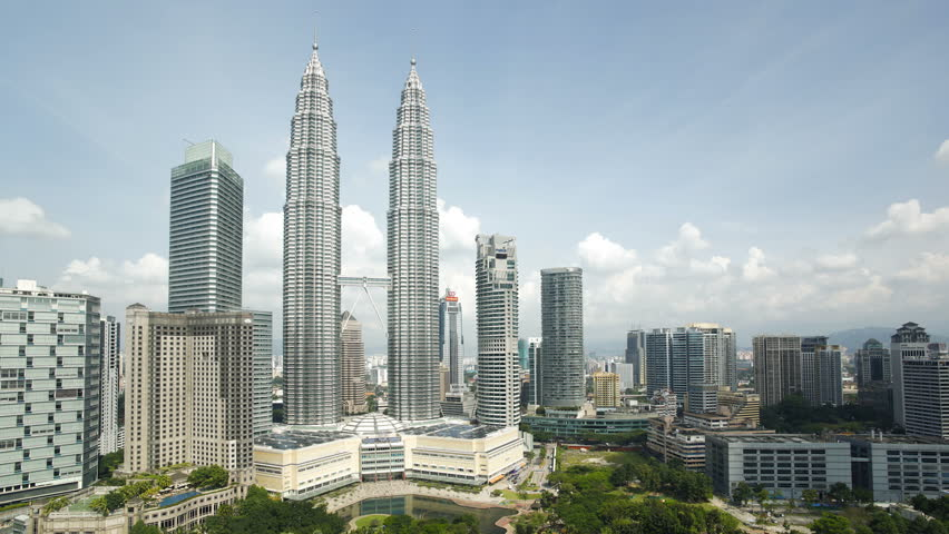 KUALA LUMPAR - CIRCA MAY 2011: Cloudscape view of the Petronas Twin Towers, Kuala Lumpur City Centre KLCC