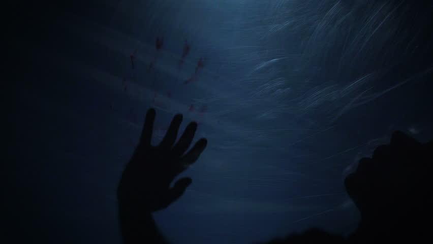 Breathless victim of psychopath behind plastic, pain and fear, cruel murder | Shutterstock HD Video #25845752
