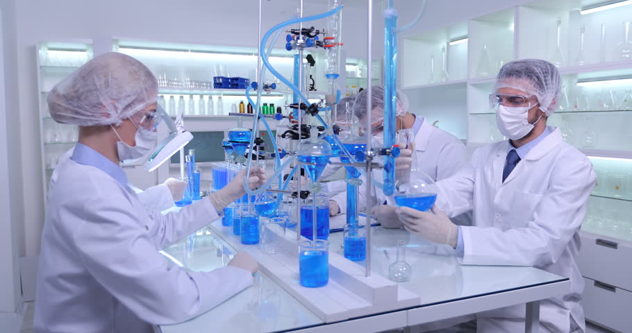 Researchers Studying Medical Treatments Team of Analysts Work Modern Laboratory #25860488