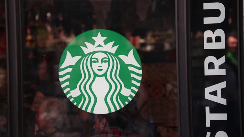 Barcelona, Spain - April 8 2017: Starbucks Coffee Logo. Starbucks Coffee Exterior Facade. Starbucks Corporation Is An American Global Coffee Company And Coffeehouse