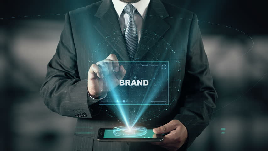Businessman with Brand hologram concept choose Marketing from words