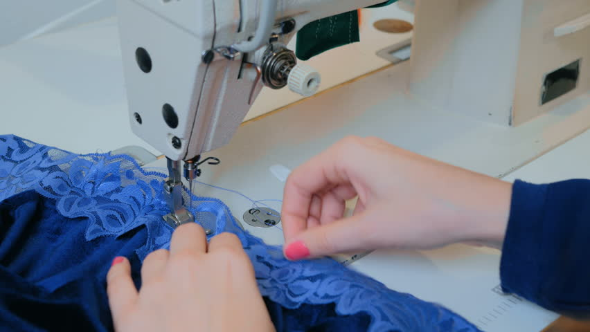 Professional tailor, fashion designer sewing clothes with sewing machine at atelier. Fashion and tailoring concept | Shutterstock HD Video #25892918