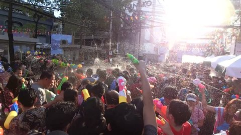 Bangkok, Thailand  April 13, 2017  Songkran Festival Unidentified people celebrate Songkran Day with water fights at Siam Square. Pouring or spraying water to people on Songkran is a Thai tradition.