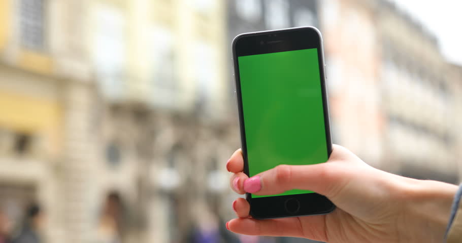 Closeup hand of woman holding vertical green screen | Shutterstock HD Video #25902818