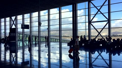 BODRUM, TURKEY - OCTOBER 13, 2016: Tourists wait for their flights back home in the modern air passenger terminal at Bodrum airport.