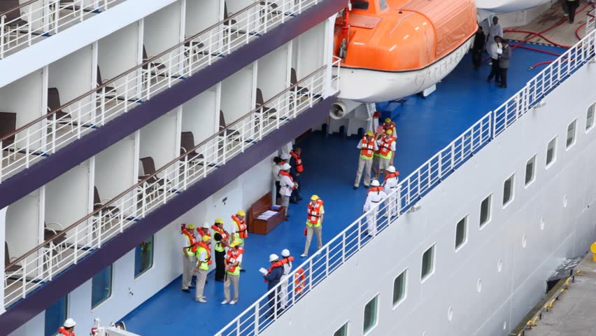 saving training of personnel in jacket on board passenger liner close up