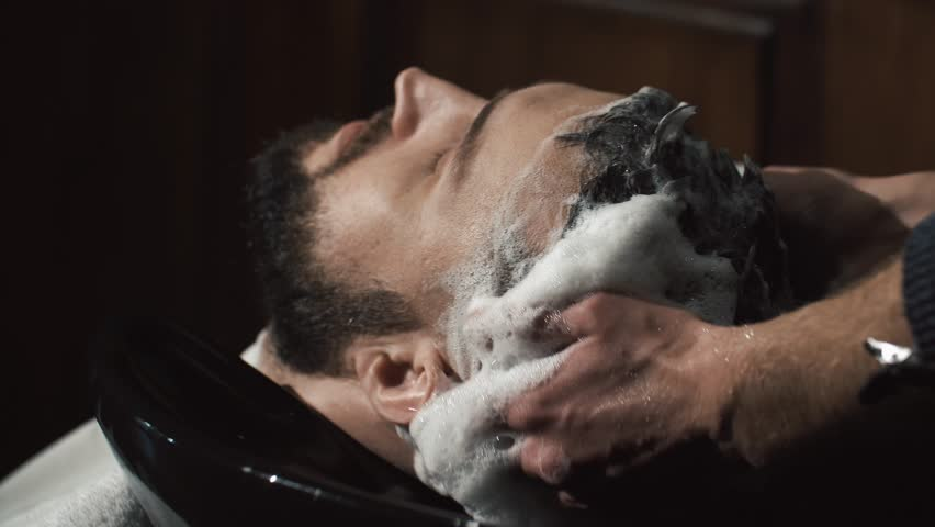 barber washing man head in barbershop #25935218