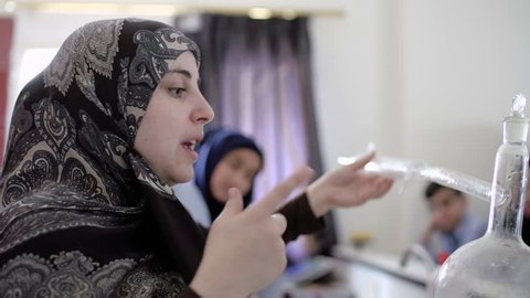 BEIRUT, LEBANON - 2016: Muslim veiled female teacher gives chemistry lesson to 6th grade students. Women make up 22.6% (2011) of the total labour force in Lebanon