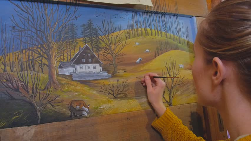 Female artist painting a landscape picture on a reclaimed wooden board   Shutterstock HD Video #25956008
