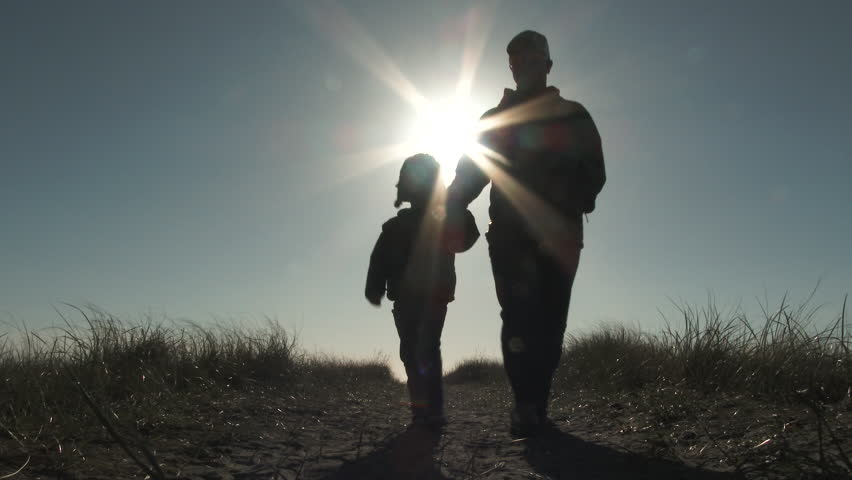 Father and son walk toward camera from sand dunes at the beach on beautiful sunny day. | Shutterstock HD Video #25969568