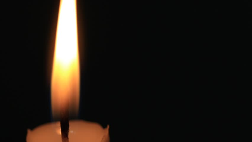 Closeup of candle on black  | Shutterstock HD Video #26001545