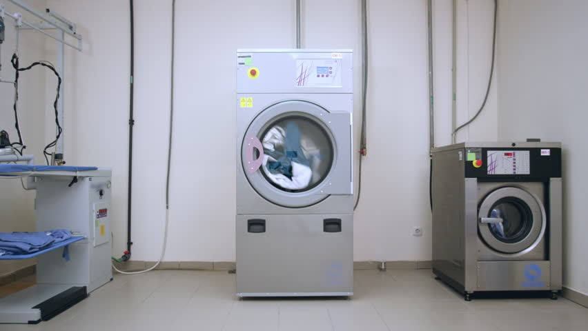 Industrial laundry room. Washer machines in laundry service. Industrial laundry machine washing clothes. Hotel laundry room. Industrial washer and dryer working | Shutterstock HD Video #26002538