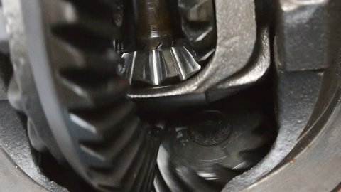 Teeth and gears of a metal gearbox close-up