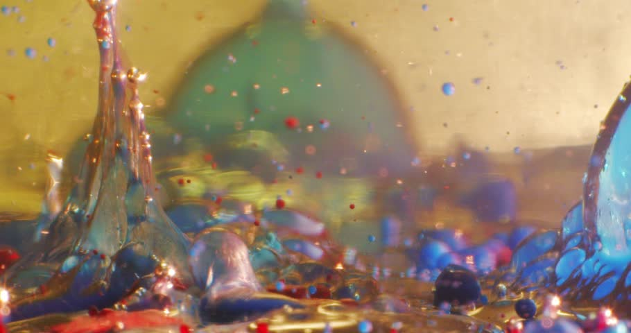 Star wars of the planet.Color drops floating in oil and water over a colorful underground with oil painting effect. Gold. 4K.