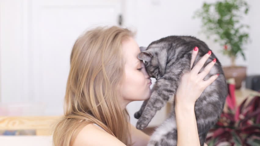 Cute woman with her cat | Shutterstock HD Video #26082368