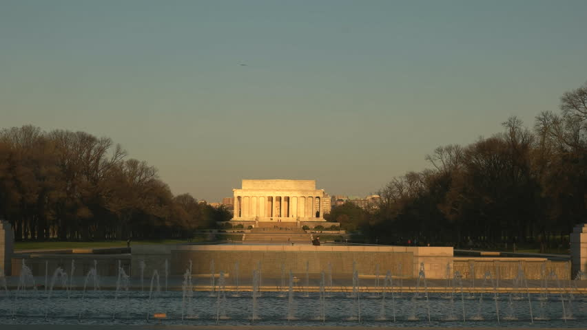 long shot of the lincoln memorial and the world war two memorial at sunrise in washington d.c.