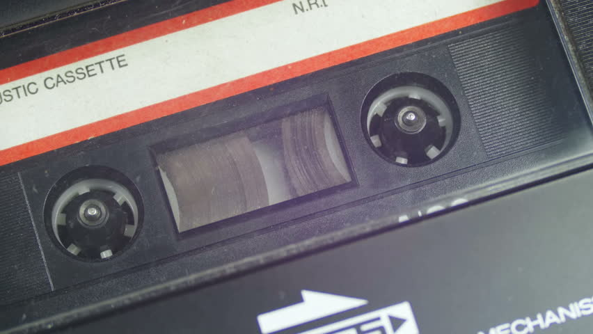 Vintage Audio Tape with White Blank Label is Rotates. Audio Tape. Macro static camera view of vintage audio cassette tape with a blank white label in use sound recording in a cassette player. | Shutterstock HD Video #26117678