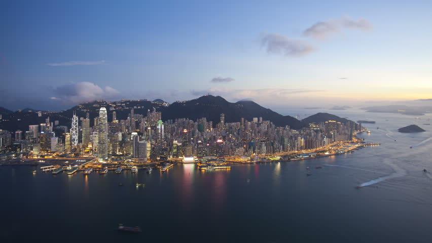 Aerial view over Hong Kong Island towards Victoria Peak showing the busy Victoria Harbour and Financial District of Central, Hong Kong, China, T/lapse   Shutterstock HD Video #2613398