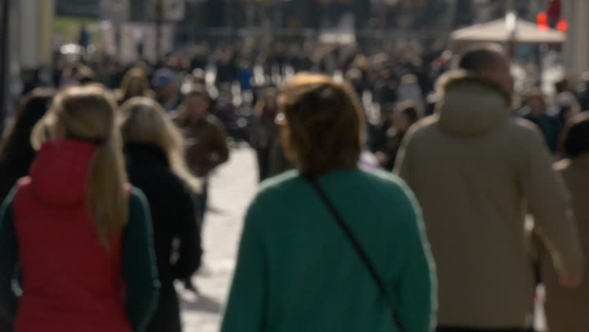 Blurred unrecognizable people walk along sunny spring street slow motion video | Shutterstock HD Video #26142752