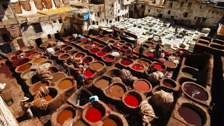 Chouwara traditional leather tannery in Old Fez, vats for tanning and dyeing leather hides