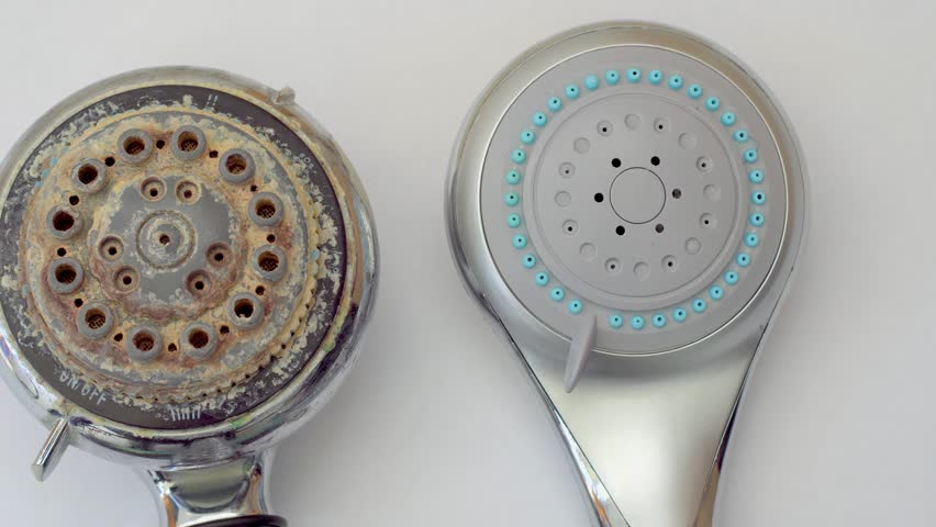 closeup of old dirty shower head and new clean shower head 4k stock