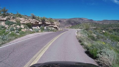 APACHE JUNCTION AZ/USA: March 23, 2017- View driving a curving steep Apache Trail with steep canyon. A first person view reveals driving with caution on potentially hazardous mountain road.