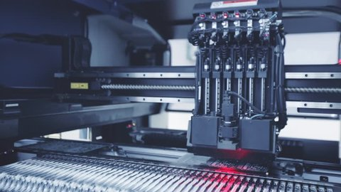 Automated Electronic circuit board production. Machine Produces Printed digital board, contract manufacturing. Manufacture of electronic chips. Robotic arm. Red light. High-tech. Full HD. Blue toning