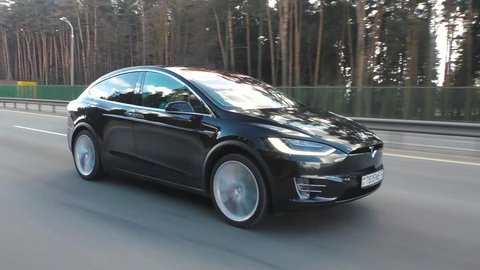 MINSK, BELARUS - APRIL 7, 2017: Tesla Model X P90D on a highway. Model X is the fastest and most capable SUV in history. It accelerates from zero to 60 miles per hour in 3.2 seconds.