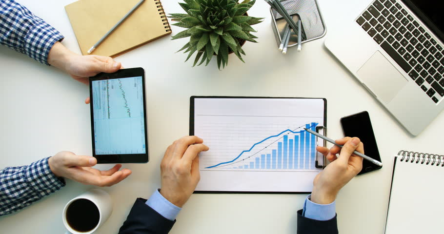 Top view business team working together at office desk and checking a financial report, men using tablet and checking financial charts. White office table   Shutterstock HD Video #26245085
