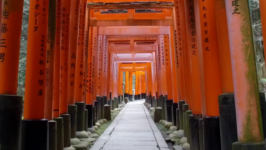 POV SLOW MOTION: Walking inside Fushimi Inari Shrine or Fushimi Inari Taisha, a Shinto shrine in Kyoto, Japan. A Japanese monument, famous for its thousands of vermilion torii gates. | Shutterstock HD Video #26278748