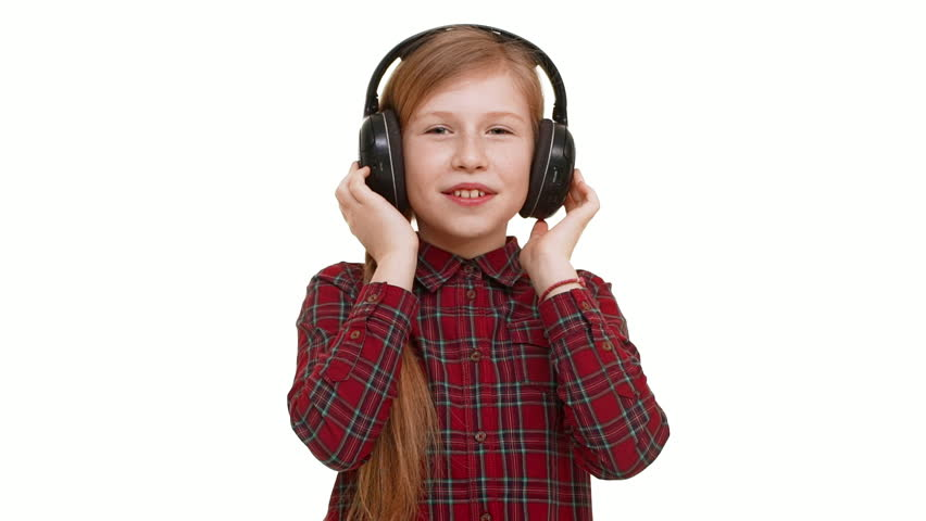 Lovely Active Elementary School Aged Caucasian Girl Listening Music Through Headphones Dancing Smiling On White