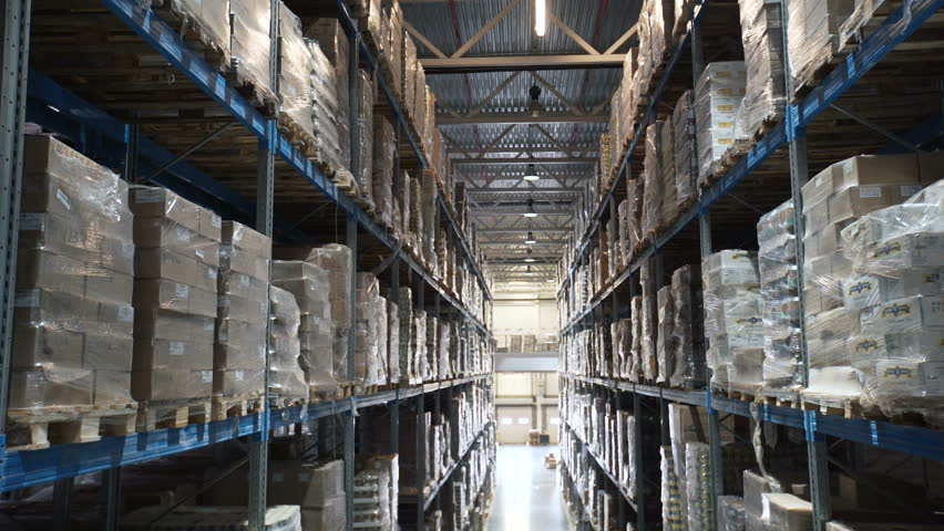 Camera moves up on shelves of cardboard boxes inside a storage warehouse. Industrial warehouse with boxes. Large warehouse logistics terminal | Shutterstock HD Video #26284322
