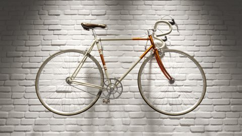 02728 camera tracking towards a vintage bicycle hanged on a white brick wall