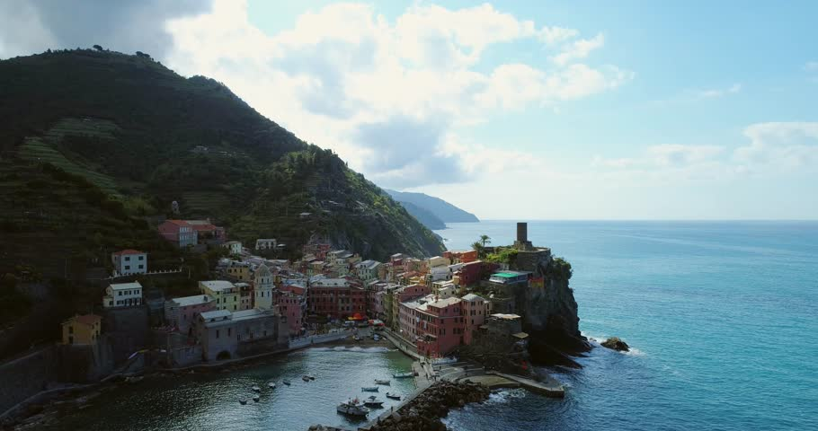 Aerial view of travel landmark destination Vernazza, a small mediterranean sea town, Cinque terre National Park, Liguria, Italy. Morning with sun and clouds. 4k aerial drone video shot | Shutterstock HD Video #26309408