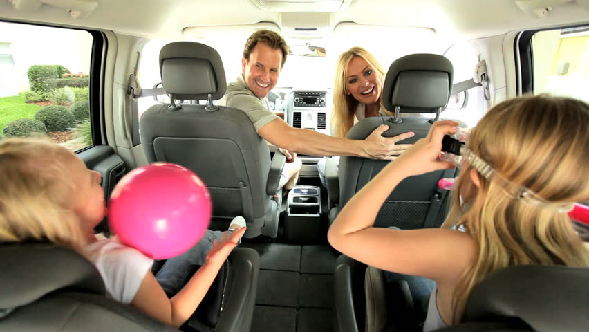 Happy Caucasian family in people carrier car ready for day beach   Shutterstock HD Video #2633585